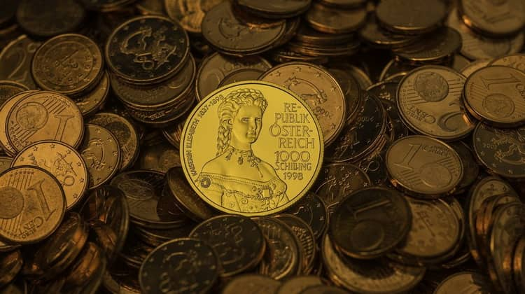 Австрийские шиллинги из золота и серебра