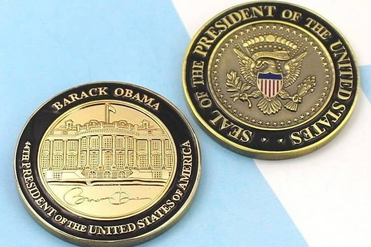 Золотая монета Обамы